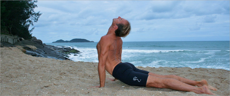 Urdhva_Mukha_Svanasana_Upward_Facing_Dog_Yoga_Pose_Clayton_Horton_on_a_beach