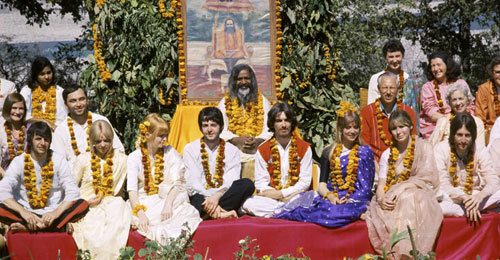 The Beatles sitting with Maharishi Mahesh